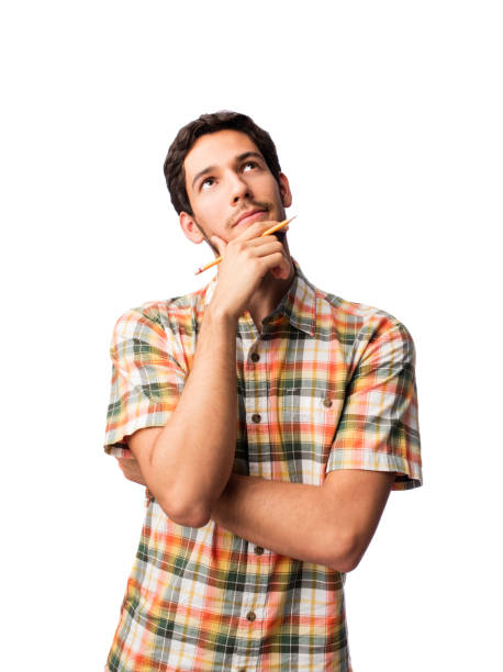 Young man looking up and thinking stock photo