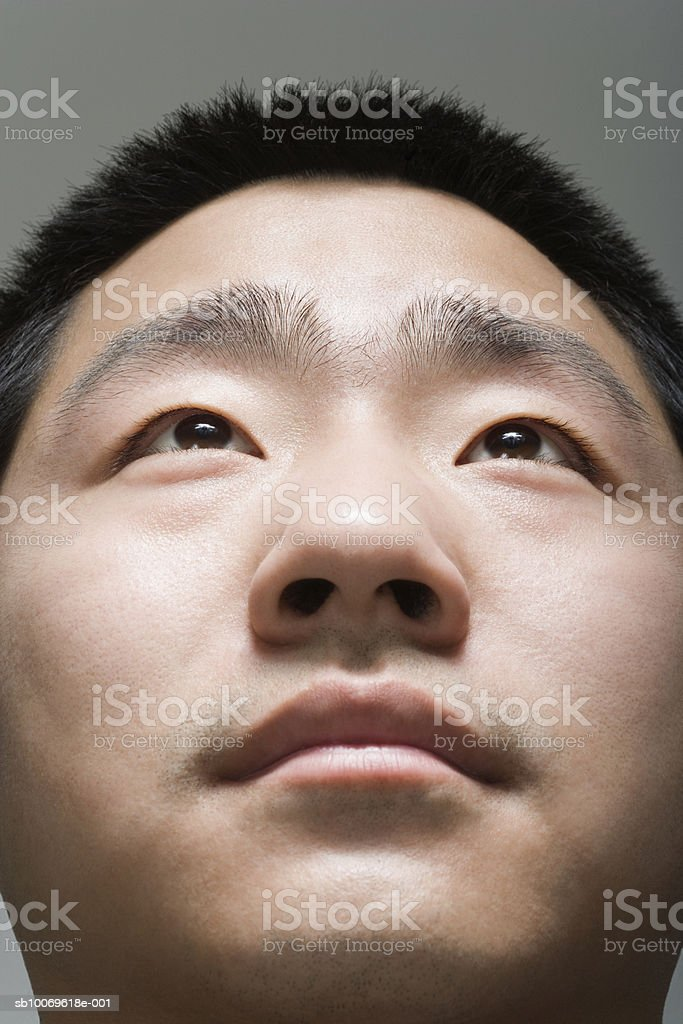 Young man looking up, close-up royalty-free stock photo