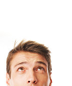 """""""close up portrait of young man looking up , isolated on the white background"""""""
