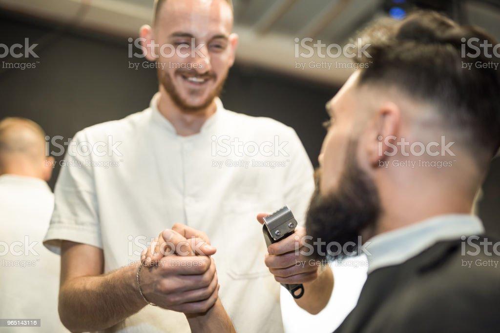 Young man loves his barber. zbiór zdjęć royalty-free