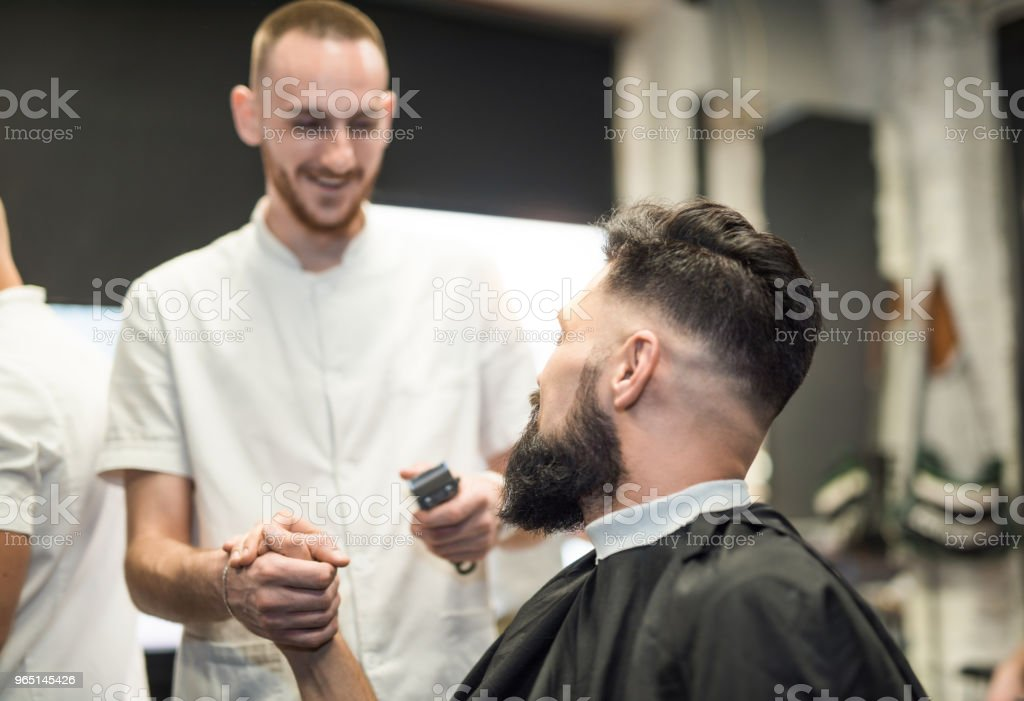 Young man loves his barber. royalty-free stock photo