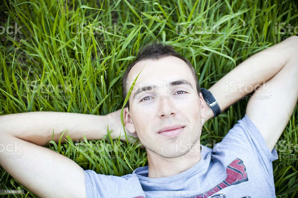 Young Man Lying On The Grass royalty-free stock photo