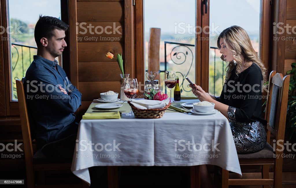 Young man mad at his uninterested wife stock photo