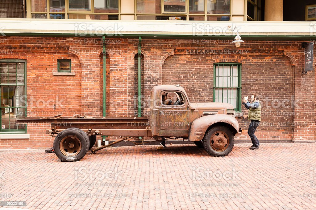 Young man make photo of girl, Distillery District, Toronto royalty-free stock photo