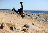 istock Young man makes extreme jump-overturn over stones. 120877602