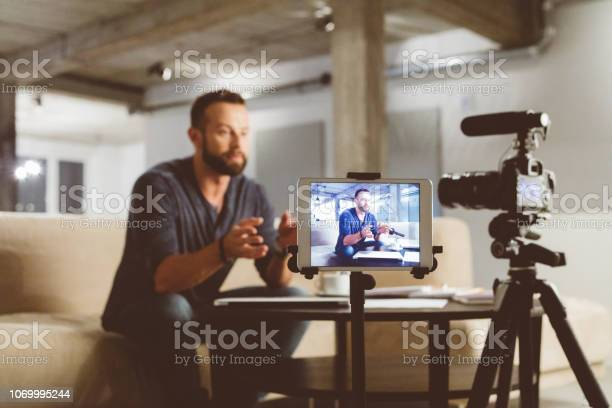 Young man making a video blog picture id1069995244?b=1&k=6&m=1069995244&s=612x612&h=xtk uynplt4jsgrrhnemcyjakqupxrrysl4su125ug4=