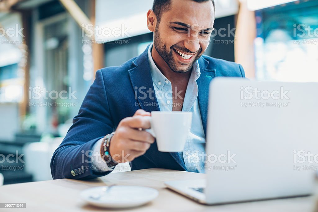 Young man making business in the coffee break stock photo