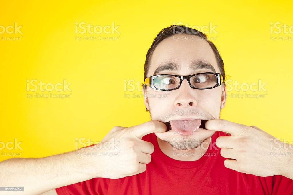 Young man making funny face royalty-free stock photo