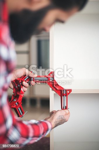 452592895 istock photo Young man making his own furniture at home 934706820