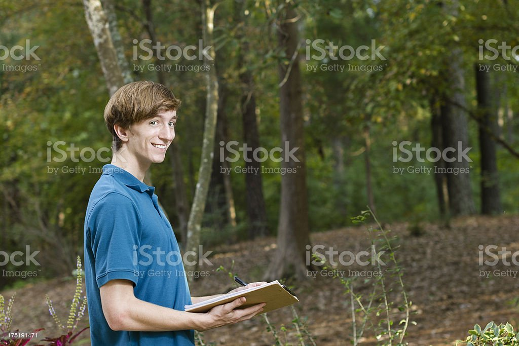 Young Man Making Notes About Forest stock photo