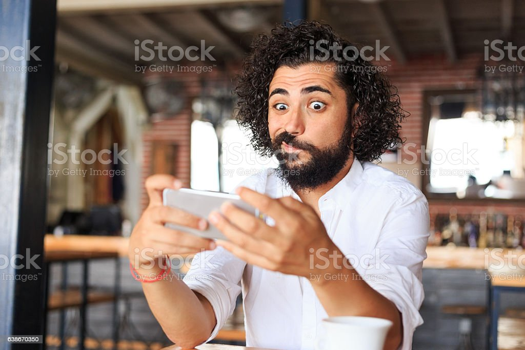 Young man making selfie in bar stock photo