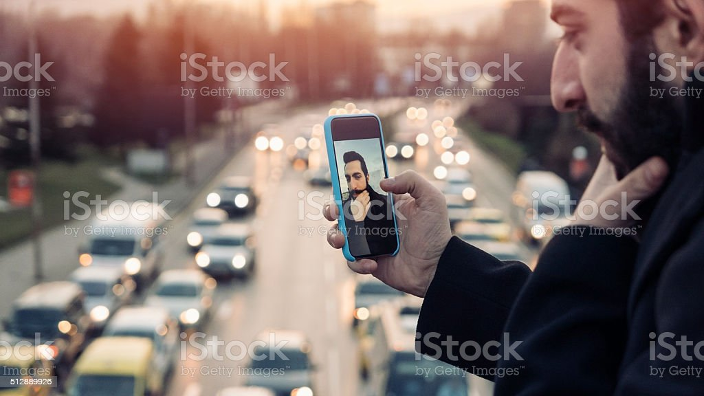 Young man making selfie stock photo