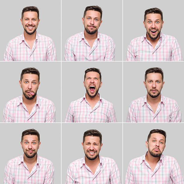 Young man making various facial expressions stock photo