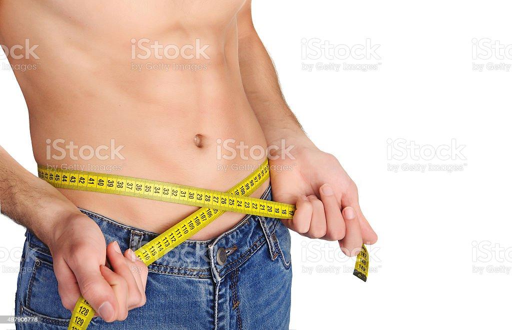 Joven medir su cintura - foto de stock