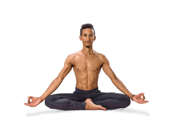Young man meditating in Lotus position isolated Young man meditating in Lotus position isolated on white background yogi stock pictures, royalty-free photos & images