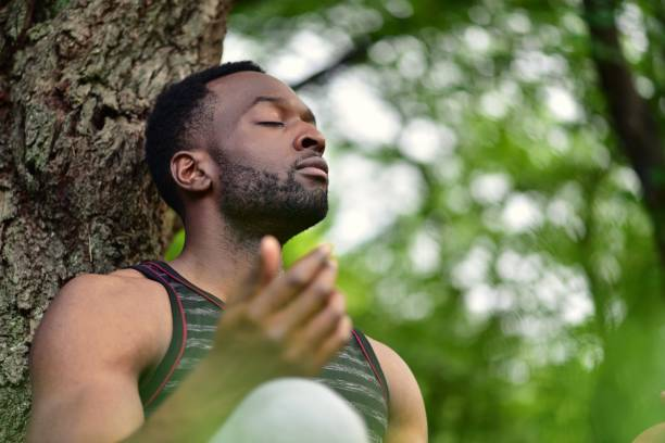 Young man meditating stock photo