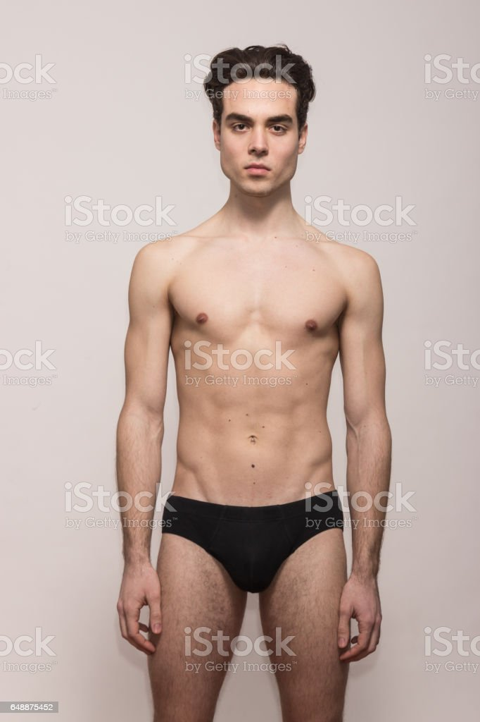 young man model posing shirtless body fit slim stock photo