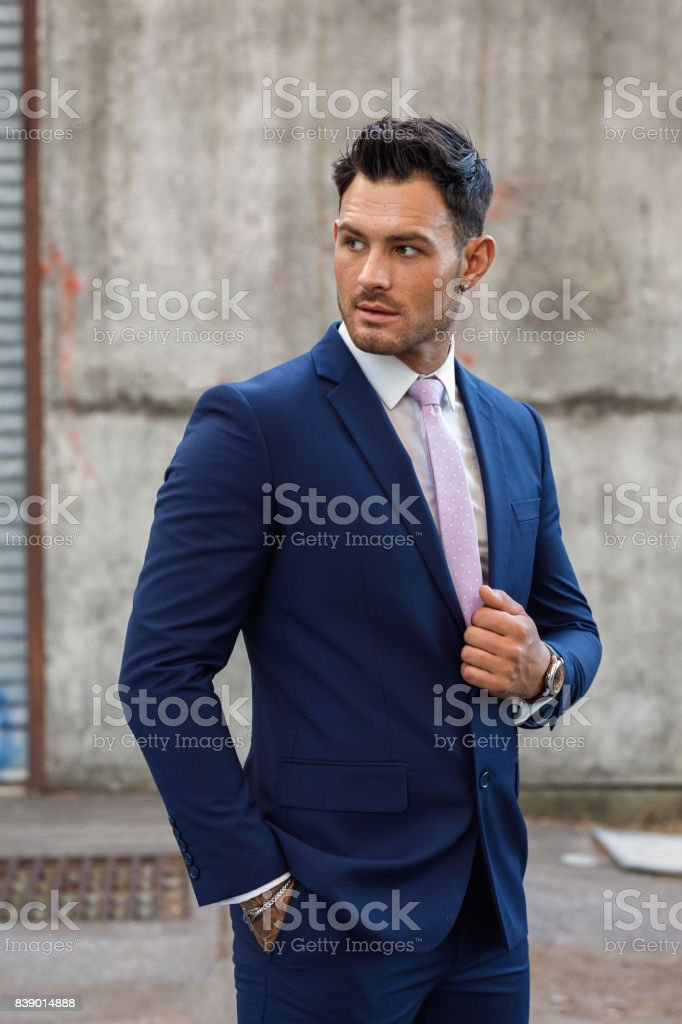 Young man modelling suit stock photo