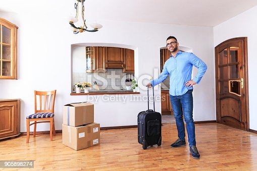 istock Young man moving in new apartment 905898274
