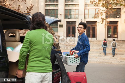 istock Young man moving into dormitory on college campus 187124418