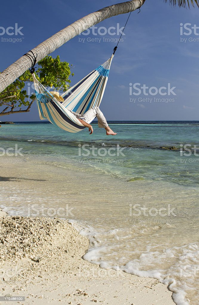 Young man napping in a hammock royalty-free stock photo