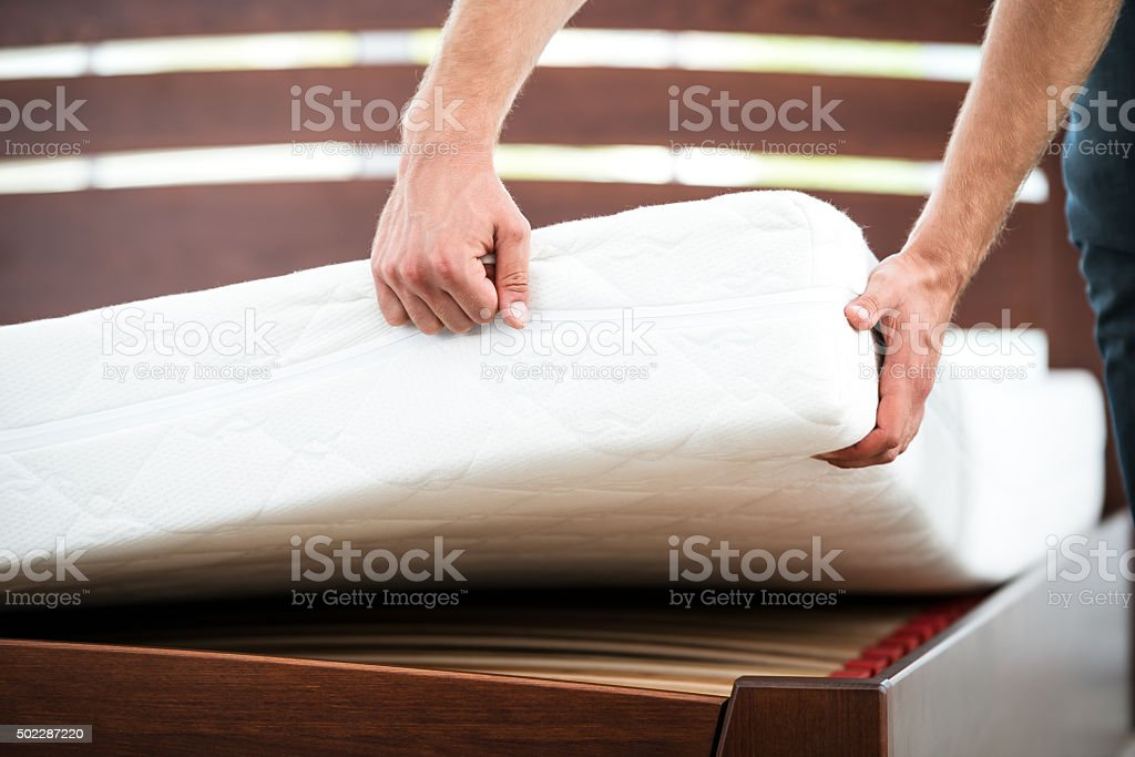 Young man near white bed stock photo