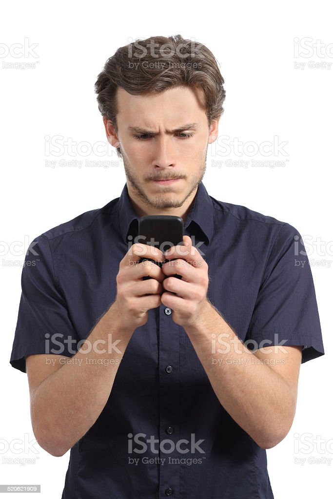 Young man obsessed with his smart phone stock photo