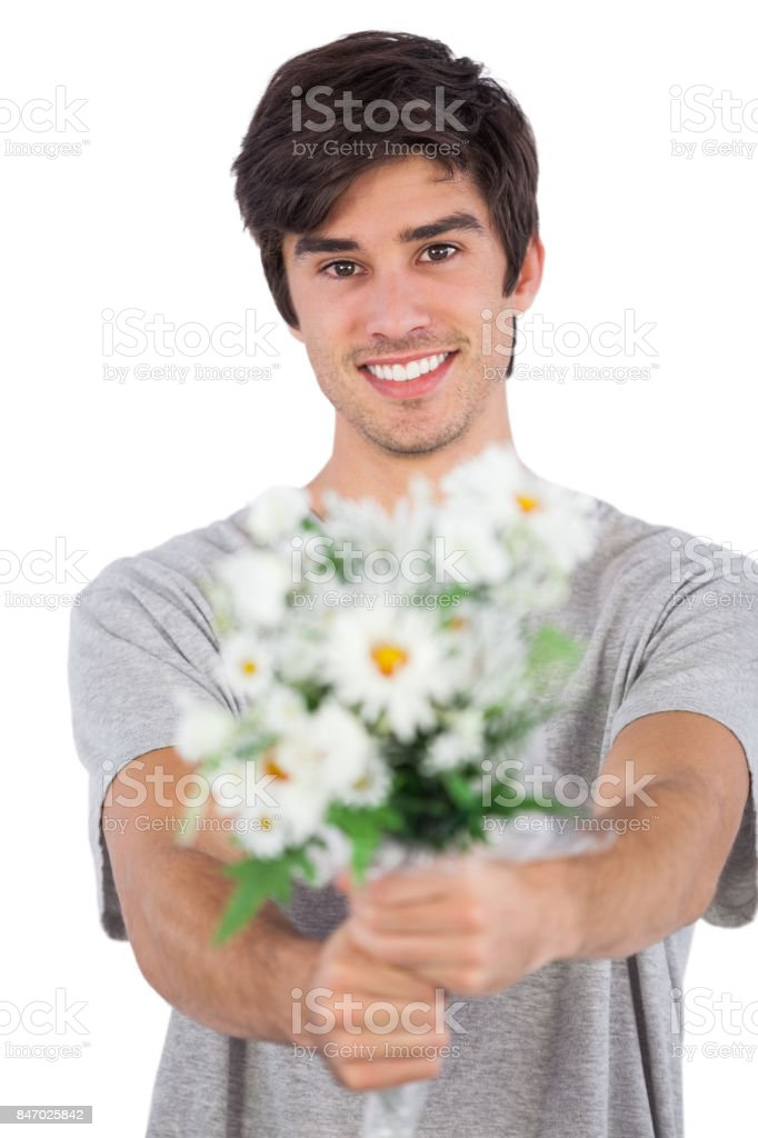 Young Man Offering A Flower Bouquet Stock Photo & More Pictures of ...