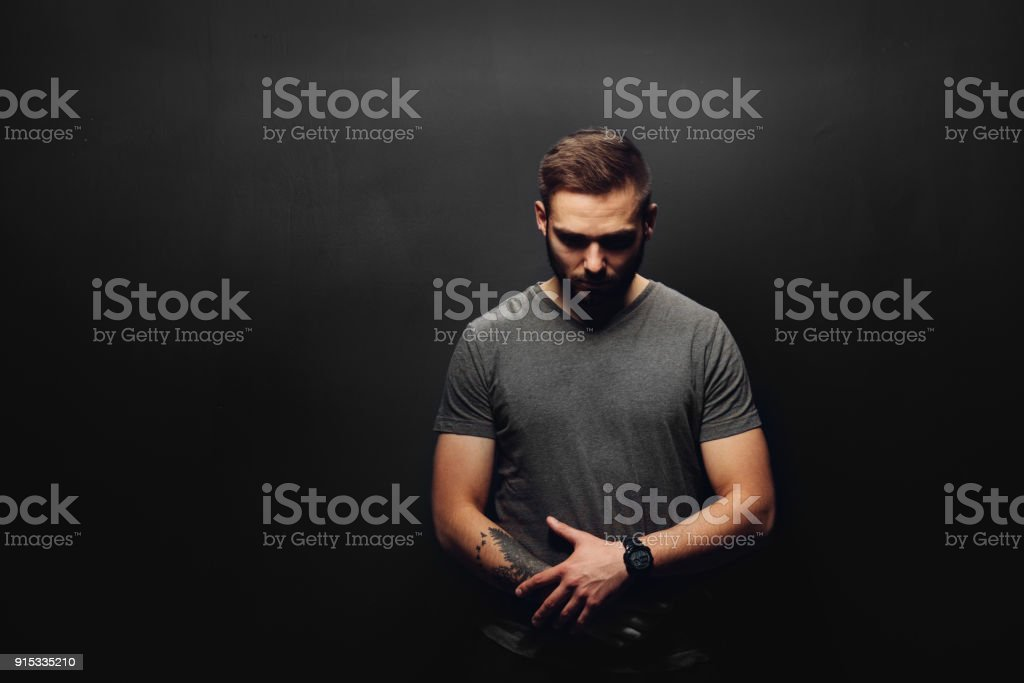 Young man on a black background. stock photo