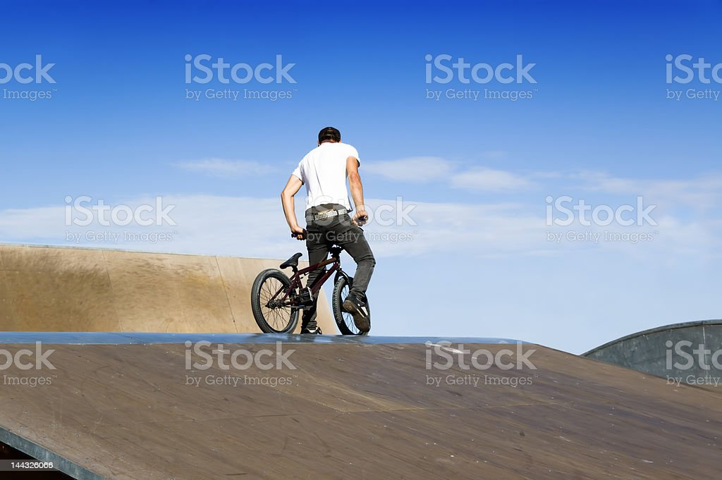 Young man on a bmx bicycle royalty-free stock photo