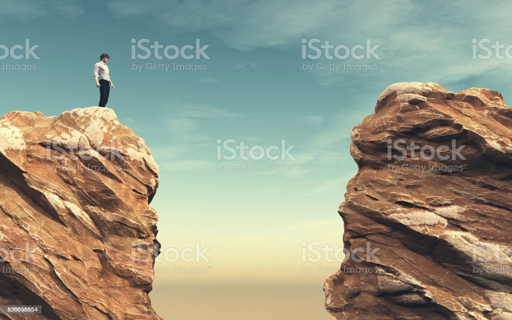 Young man on a rock stock photo