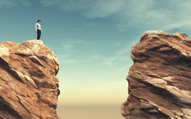 young man on a rock - cliff stock pictures, royalty-free photos & images