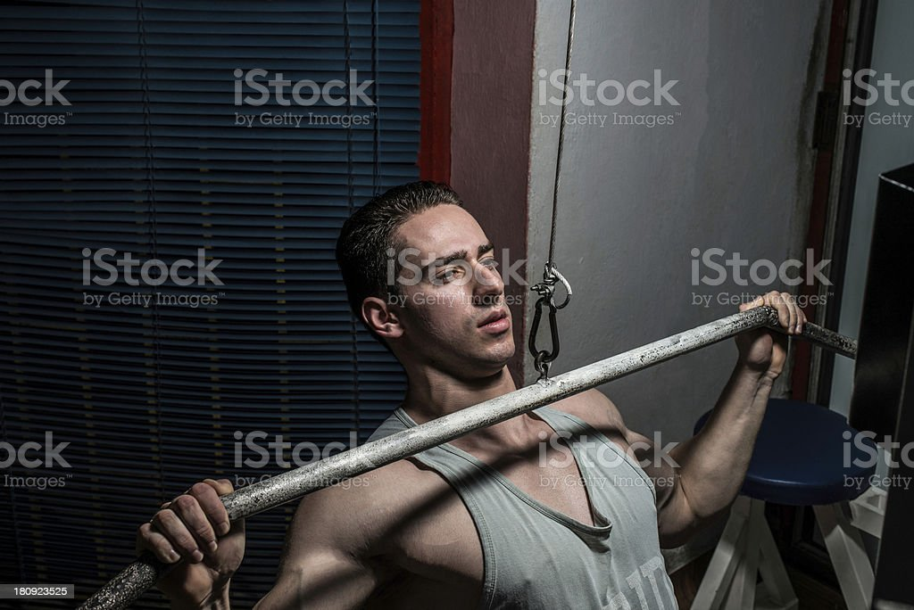 young man on a rowing machine royalty-free stock photo