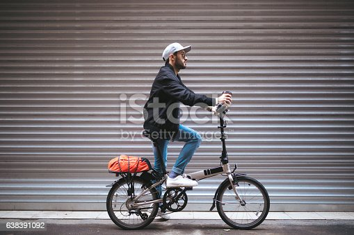 Young man on bicycle.
