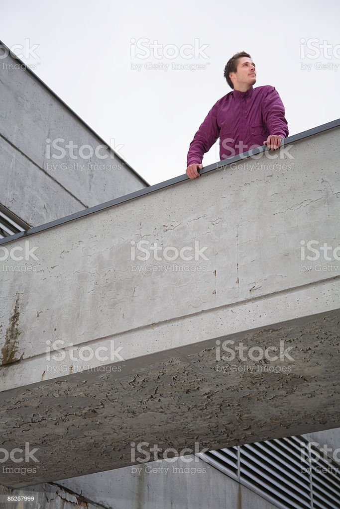 Young man on bridge royalty-free stock photo