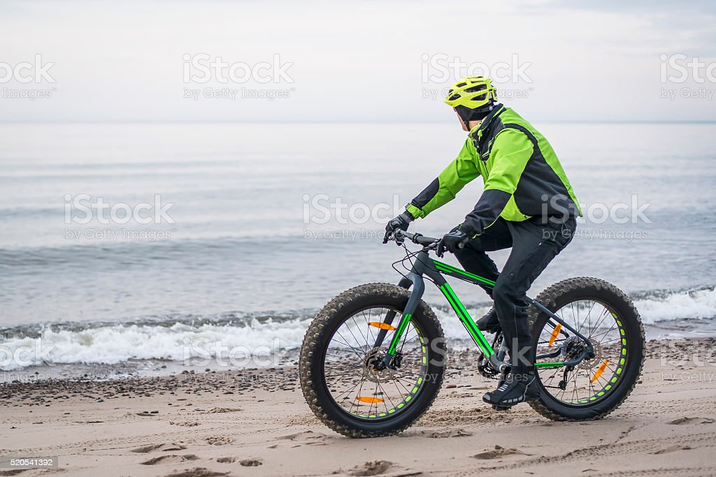 Young man on fat bike stock photo