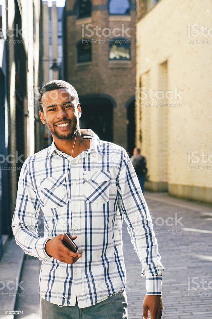 Young Man On His Mobile Phone Outdoors stock photo