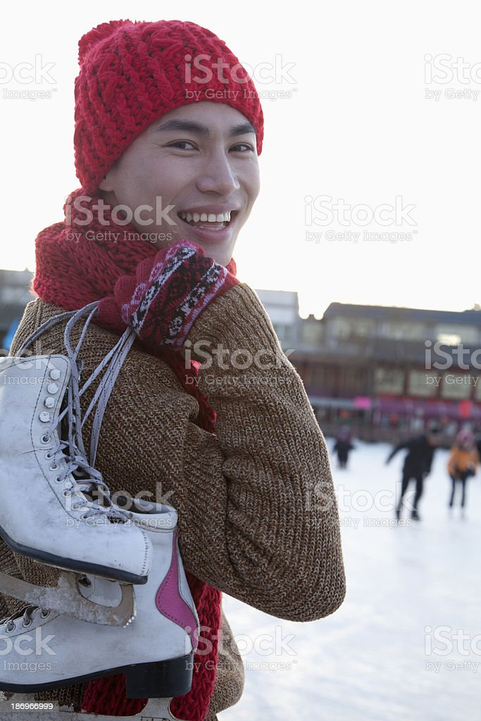 Young man on ice rink royalty-free stock photo