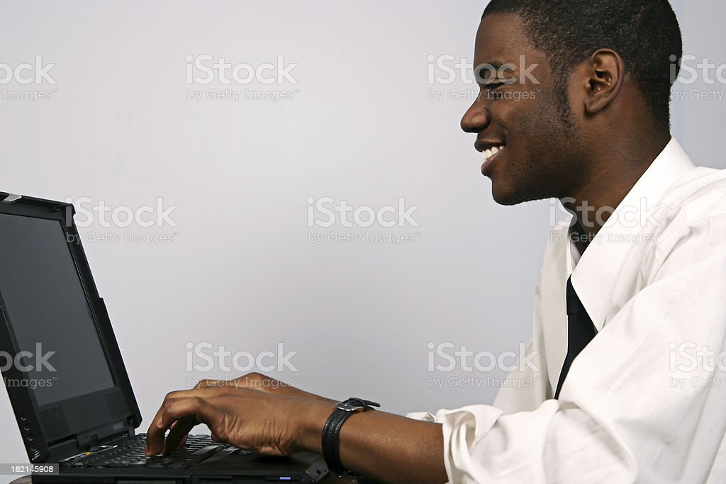 Young Man on Laptop stock photo