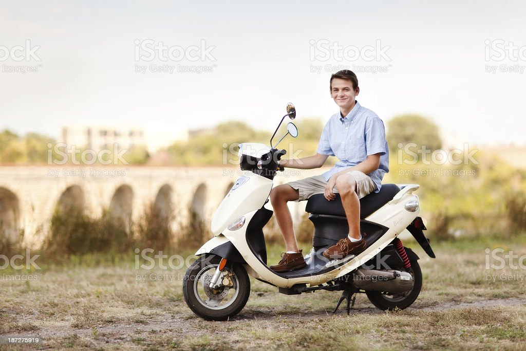 Young Man on Moped Scooter stock photo