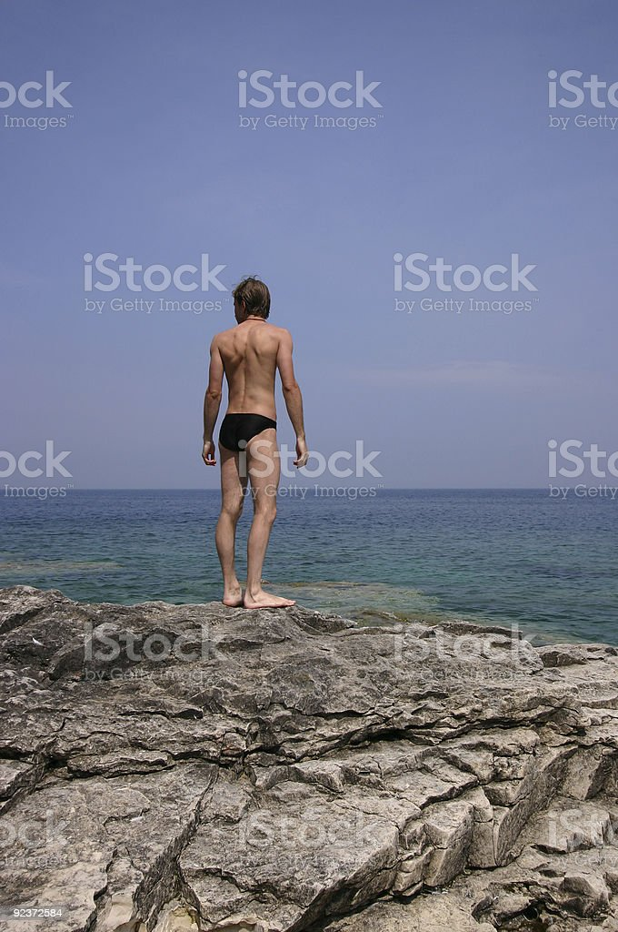 Young Man on rocky beach royalty-free stock photo