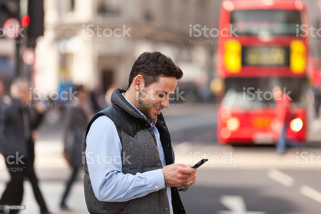 Young man on street in London royalty-free stock photo
