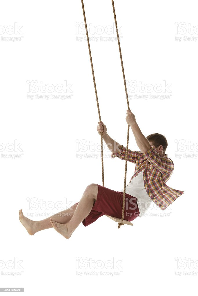 Young man on swing rope royalty-free stock photo