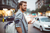 istock Young man on the streets of big city. 490845654