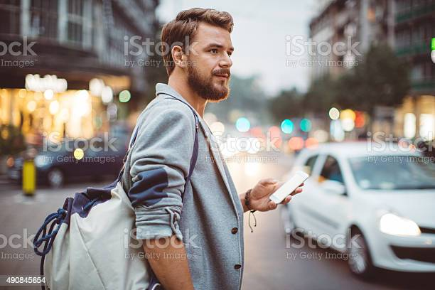 Young Man On The Streets Of Big City Stock Photo - Download Image Now