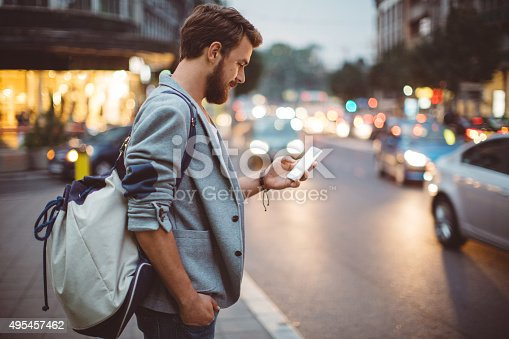 istock Young man on the streets of big city. 495457462