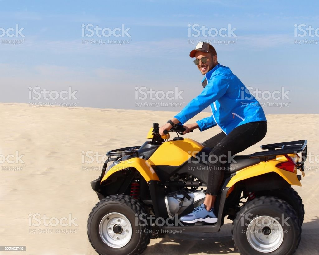 A young man on the wheeler stock photo