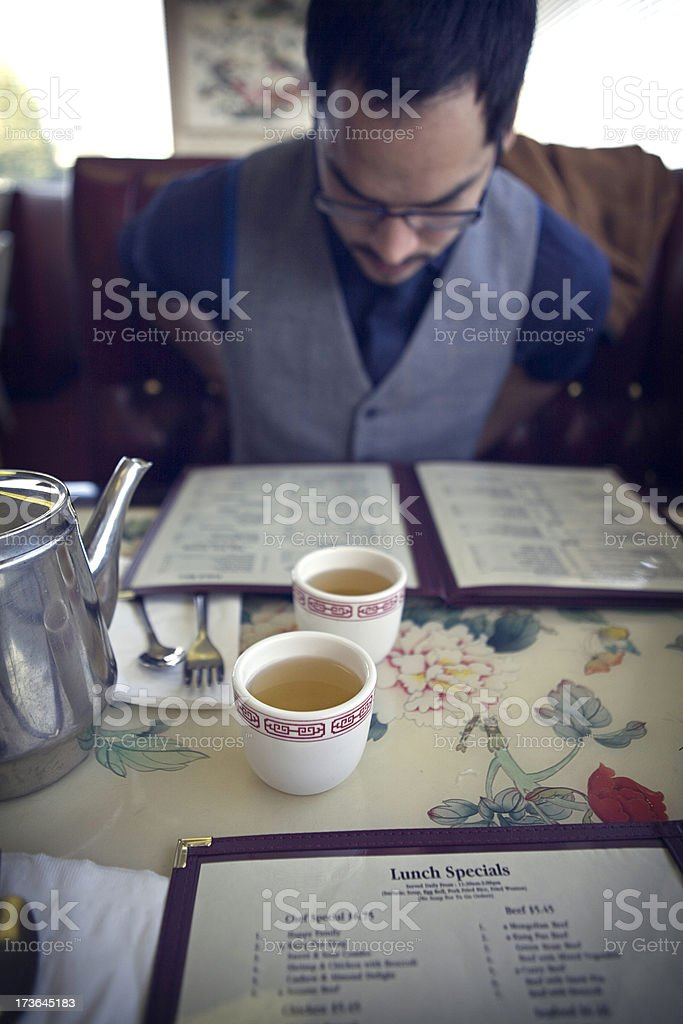 Young Man Ordering Food From a Restaurant Menu royalty-free stock photo