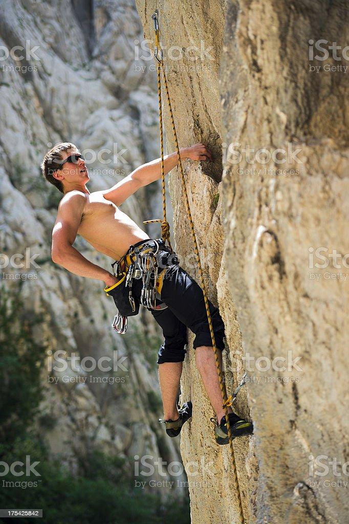 Young man outdoor climbing royalty-free stock photo