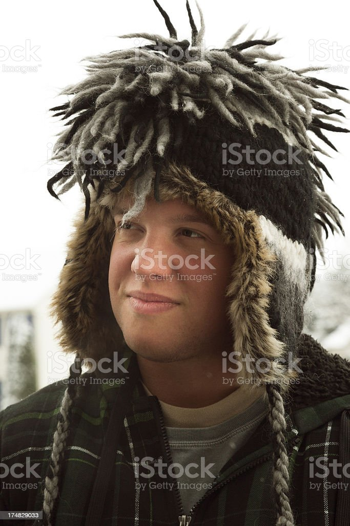 Young Man Outdoors in Winter Hat stock photo